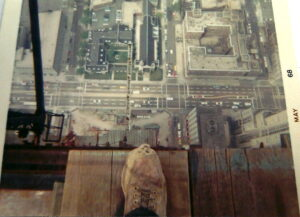 Iron worker on top of the Hancock Building, no safety tie off, overlooking Michigan Avenue, Chicago (1968)